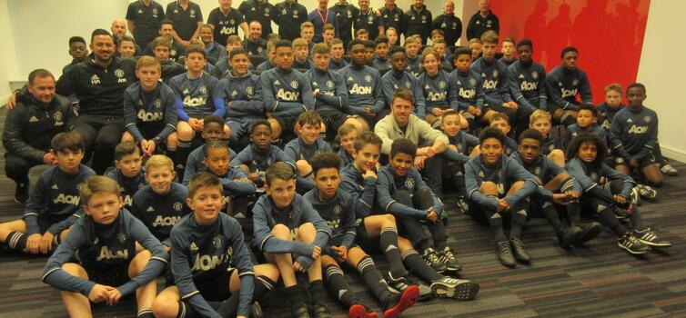 Michael Carrick with Manchester United Foundation Phase players