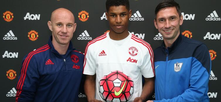 Marcus Rashford receives an award after graduating to Man Utd's first team