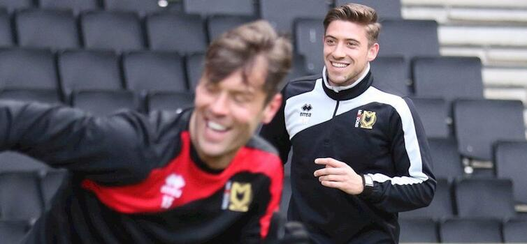 Willmott (right) started his career as an intern with MK Dons