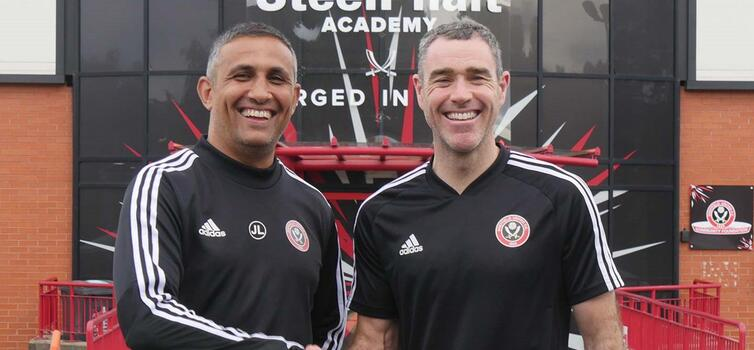 Hughes (right) with Academy Manager Jack Lester