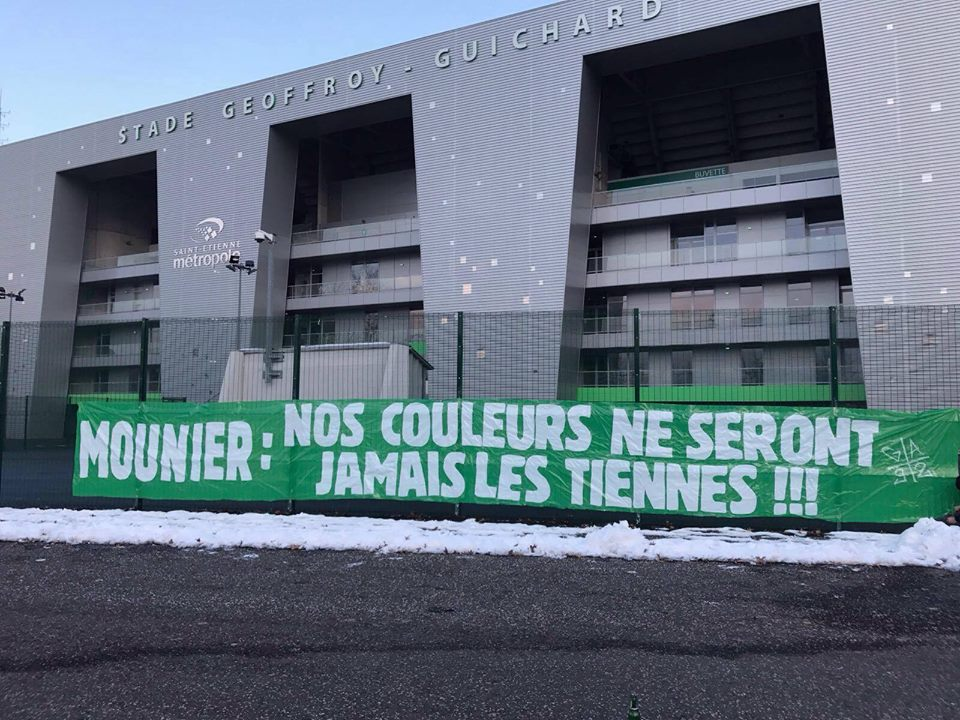 "Fans put up a banner reading: ""Mounier, our colours will never be yours."""