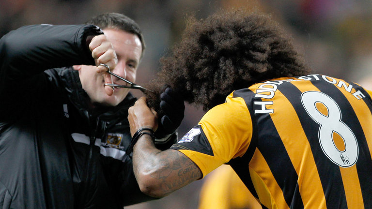 Price doing a spot of hairdressing with Tom Huddlestone at Hull